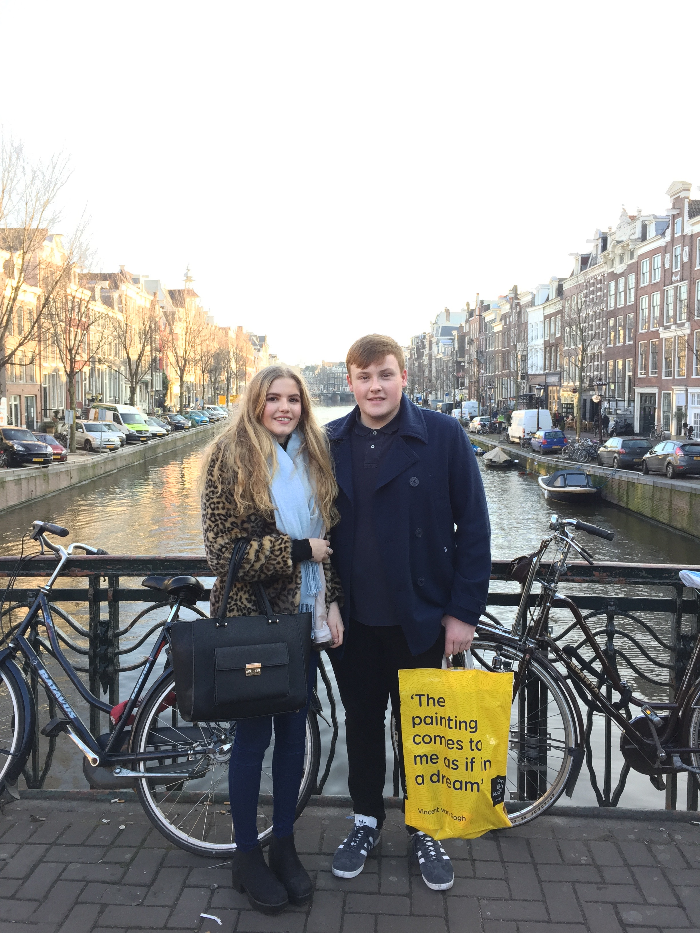 How-to-spend-a-long-weekend-in-amsterdam-couple-on-canal-bridge